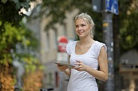 Germany, North Rhine Westphalia, Cologne, Young woman with digital tablet (thumbnail)