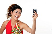 Young woman clicking her own picture, mobile phone