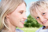 Germany, Cologne, Mother and son smiling, close up