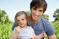 Germany, Cologne, Father and daughter smiling, portrait