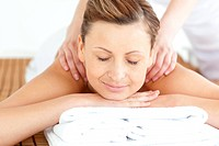 Relaxed woman enjoying a back massage