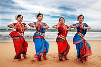 Odissi dancers striking a pose