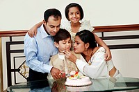 Boy celebrating his birthday with family
