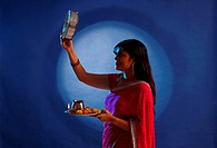 Woman performing a ritual of Karva chauth