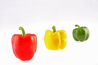 Close up of different capsicum in a row