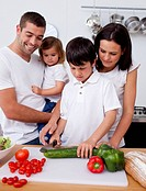 Little son preparing food with his family