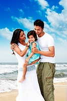 Young couple with their kid at a beach