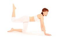 Junge sportliche Frau macht Gymnastik