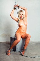bondage art style with blond woman cuffed in chains