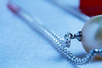 Close up of a pearl necklace, selective focus