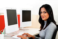 Young businesswoman operating a computer