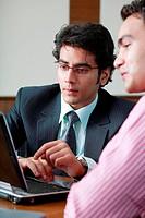Businessmen working on laptop