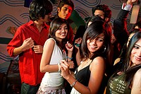Young men and women dancing at a party