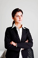 Businesswoman standing, arms folded