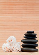 Roses and a black pebbles stack