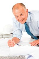 Senior man work on blueprints construction plans