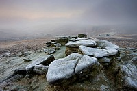 Frost covered granite outcrop on Hookney Tor, with thick fog descended over the moorland landscape, Dartmoor National Park, Devon, England, United Kin...