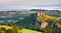 Carreg Cennen Castle at dawn on a misty summer morning, Brecon Beacons National Park, Carmarthenshire, Wales, United Kingdom, Europe