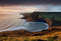Storm light illuminates Chapmans Pool and Houns Tout cliff, viewed from St. Aldhelm´s Head, Jurassic Coast, UNESCO World Heritage Site, Dorset, Englan...