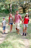 Family walking in countryside