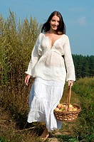 Rural women´s portrait with basket of apples