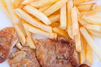 Chips and cooked pork fillets