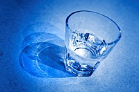 glass of water in blue tone