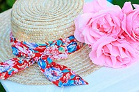 Lovely pink roses and a straw hat