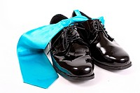 Shiny men&039,s dressy shoes and blue tie
