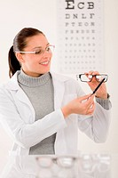 Optician doctor woman with glasses and eye chart