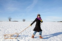 Woman pulling a sleigh