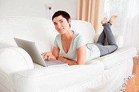 Happy short_haired woman with a laptop