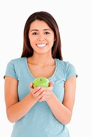 Lovely woman holding a green apple