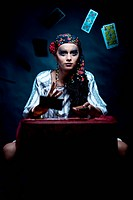 a portrait of a gypsy fortune teller throwing the tarot cards.