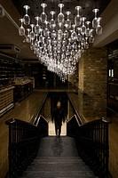 Hedonism Wines, London, United Kingdom. Architect: Universal Design Studio, Speirs + Major, 2012. Ground Floor view with chandelier.