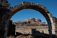 Looking through archway across theater to Ottoman fortress in Tlos