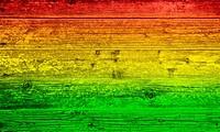 Holzbrett Hintergrund in Reggae_Farben