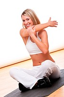Fitness series _ Smiling woman stretching