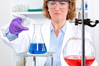 Female scientist at work with chemicals
