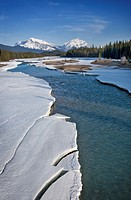 Frozen river and mountain peaks - drive from Banff to Jasper, Canadian Rocky mountains, Canada