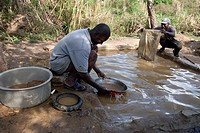Artisan miners panning for gold. They are working on the site of a mine that was shut in the 1960s. It is now used by artisan miners who extract the s...