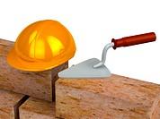Trowel, bricks, yellow plastic helmet