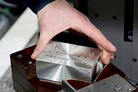 Precious metals factory. Close_up of a worker weighing a stamped bar of palladium at the Krastsvetmet non_ferrous metal plant, Krasnoyarsk, Siberia, R...