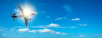 Jet cruising in a clear blue sky. Panoramic composition in high