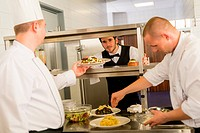 Professional kitchen cook prepare meal give waiter
