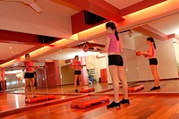 Woman doing fitness exercise in gym