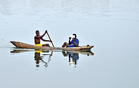 People on row boat. Okavango river, Namibia