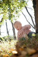 Baby sitting in a forest