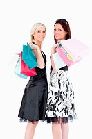 Joyful well_dressed women with shopping bags