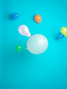 blue background with colored balloons floating